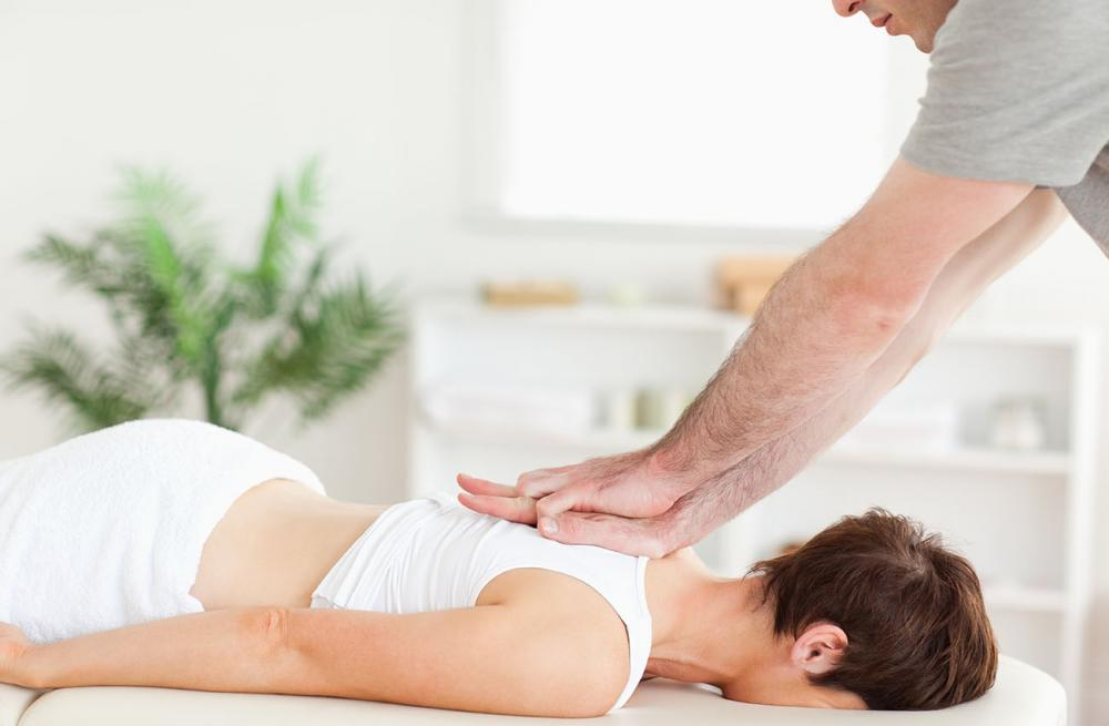 Woman receiving massage therapy at Rose Healthcare Centre in Orlando, FL.